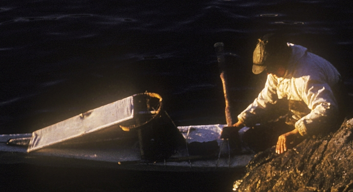 Greenland 1959: Ummannaq, man entering his kayak.